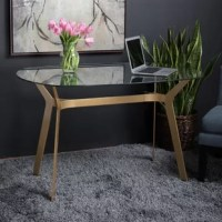 The mid-century inspired the design of the writing desk makes it a sleek and elegant addition to your home office. The boomerang-shaped legs have a unique gold tone, powder-coated finish. The thick, tempered glass top floats over the angled legs making it perfect for small spaces. The modern, simple lines of this work table allow it to be used in almost any room in the house. It seamlessly can be used in your entryway or bedroom, and of course, in your office.