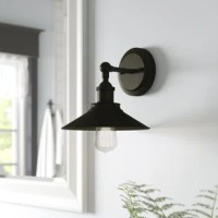 This 1 light indoor wall fixture with metallic bronze shade interior is a charming retro-industrial design. This distinctive wall light adds an inviting ambiance to any space. Install in a bathroom, bedroom or hallway. The manufacturer is a trusted and global brand. They know lighting and offer products with exceptional quality, reliability, and functionality.