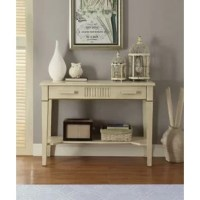 This transitional style console table will make a connection between traditional details and modern designs to make it useful in the present life. Constructed from solid wood, it features a single drawer with wooden handle and incorporates an open bottom shelf. It is supported by tapered legs, providing stability and durability.