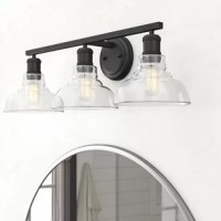 This 3-Light Vanity Light has a cool, industrial design that will be the finishing touch in any bathroom especially those with modern and transitional styles. This bath light will add a sleek look to a bathroom with clear glass shades. This fixture is safely rated for all damp locations and is easy for anyone to install since all mounting hardware is included. This fixture will bring out all refined details in a bathroom because the durable and elegant construction of this bath light is...