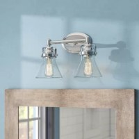 This nautical-inspired bath vanity features seedy glass cones suspended by a yoke frame finished. The glass offers abundant lighting and compliments the styling of the fixture. Make it a more industrial look by adding filament E26 light bulbs.
