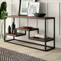 Set the stage in the entryway or bring organizational appeal to the living room with the help of this console table. Its frame is crafted from tubular metal and accented by solid and manufactured wood shelves to create an on-trend mixed material look at home in modern or rustic-inspired ensembles. A high-low shelf acts as a stylish stage for decorative accents, DVD players, and more, while the top leaves plenty of room to spread out family photos, lamps, or other must-have accents.