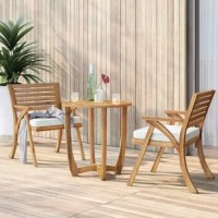 Even if your patio is petite, you can still enjoy coffee or cocktails outside with this compact three-piece bistro set. Crafted from solid acacia wood, this weather-resistant set includes one round table and two matching chairs in a wood grain finish to highlight the character of the natural wood. Each chair is topped with a neutral-hued cushion with a removable polyester-blend cover to provide 3