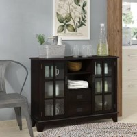 Extremely functional, this Dule 2 Drawer 2 Door Accent Cabinet features both open storage and drawer and framed glass door storage. The walnut finish and black arts and crafts hardware are helpful in blending into any decor.