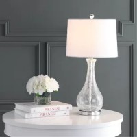 """Crafted from chic clear glass, this luminary provides ambient light to any space in need of a little sparkle! We especially love the crackle-like detail throughout the base, giving this piece the look of an antique *without* the years of wear and tear! For a touch of on-trend contrast, this piece also features a silver metal base and finial that really ties the look together.   """"Worth it!"""" alert: an LED bulb is included, so you can start enjoying this lamp the moment it arrives!"""