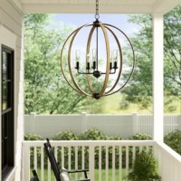 This Outdoor Chandelier makes an elegantly rustic statement by blending warm wood tones with hardware on a modern orb silhouette.
