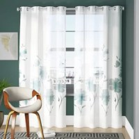 Add an airy layer to any ensemble with this curtain panel. Its pastel floral motif lends your space a touch of natural appeal, while the semi-sheer transparency lends you a little privacy. Crafted from fade and stain-resistant polyester, this design can be placed into the washing machine for super easy upkeep. Grommet headers allow you to drape this piece using the curtain rod of your choice. This includes a single curtain panel.