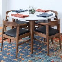 Complement a small dining space or a bay window breakfast nook with this rustic dining table. Crafted from solid wood, it features a smooth-colored stain that adds a touch of mid-century modern style to your space, and four slim tapered legs that give it a streamlined silhouette. Measuring 43'' L x 43'' W x 29.5'' H, the spacious surface top showcases a smooth finish and can easily support a group of four. Serve a casual dinner with family, or happy hour cocktails with your friends.
