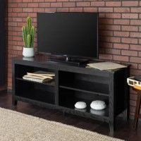 Fusing fashion with function, this TV stand is the ultimate focal point for your living room look or den ensemble. It includes four open shelves for keeping DVDs and media players. Crafted from manufactured wood, its frame features a clean-lined silhouette and neutral solid finish for an understated appearance that's perfect for just about any abode.