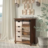 An even mix of function and farmhouse flair, this accent cabinet makes a statement as it provides a place for any odds and ends strewn about your space. Crafted from manufactured wood and fir wood, it features four drawers and one sliding door outfitted in several hand-painted rustic finishes for eye-catching appeal. Distressed details dot this design for a weathered look, while iron hardware offers up an industrial edge. Measuring just 31.7'' H x 24.8'' W x 14.6'' D, this compact piece is an...