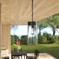Old world style and contemporary design combine in this one-light outdoor hanging pendant! Crafted of metal in a dark oil-rubbed bronze finish, this fixture features a simple drum-shaped body. Ensconced in an oversized cylindrical clear glass shade, one 100 W incandescent E26 Edison bulb (not included) disperses bright light throughout your outdoor space. Rounding out the design, an adjustable length of chain suspends the unit from a matching canopy above.