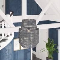 In the Pendant, gray polyester weaves around a bell-shaped body in lattice crochet. The result is a gleamy, see-through shade that offers a subtly softer take on modern design.