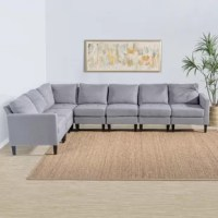 Fit the whole family for movie marathons and board game nights alike with this clean-lined sectional, offering seating for seven. Made with a solid and manufactured wood frame, this budget-friendly piece is filled with foam and supported by a mix of a pocket and sinuous spring. Polyester upholstery in a solid hue envelops the design, giving it the versatility to blend with your existing arrangement, while tapered wooden legs below sport a dark brown finish for even more understated appeal....