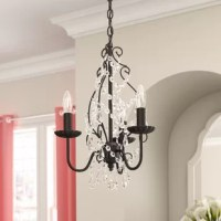 This collection contrasts the intensity of an oil-rubbed bronze frame with the lovely delicacy of shimmering royal-cut crystals. Elegant descending branches swoop up to display three to five shimmering lights (not included) held in rippled bobèches. A flowing festoon of crystal octagons accented with clear almond-shaped crystals glimmers at the center of the stylistic scrolled frame. A crystal drop anchors the light and adds visual interest. The fixture comes in adjustable heights.