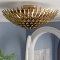 A little illumination goes a long way. Just take this flush mount for example: measuring just 9'' H x 24'' W x 9'' D, it may be small, but it still brings a bit of style and shine to your entryway or kitchen ensemble. Crafted from metal, it features a layered petal design reminiscent of a bold flower bloom all finished in a versatile metallic tone. It requires six bulbs to make it gleam.