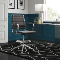 Give your office a contemporary update with this must-have desk chair. Crafted from metal, its frame features a streamlined silhouette and a sleek chrome finish for a pop of polish. A five-wheel rolling base allows for easy mobility, while a side lever lets you adjust the height from 22'' to 29.5'' in height. Vinyl upholstery wraps around the seat and back for comfort, perfect for when you're working long hours.