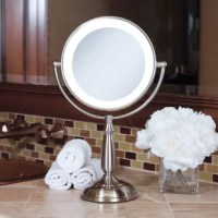 """A lighted vanity mirror is an absolute """"must-have"""". Looking your best is easy when you have a lighted and magnified vanity mirror at your side. It makes doing your hair and make-up easier than ever before. This Super Bright LED Lighted Round Vanity Mirror features a dual-sided, premium quality mirror with two magnifications. On one side, a 10x magnification mirror allows you to see up-close and in detail, allowing for easy make-up application. The other side features a normal, 1x..."""
