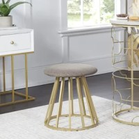 Curate a luxurious pampering space for yourself with the Angela Vanity Seat. The lightly textured weave of the round linen seat creates a lovely contrast against the glamorous finish of the metal drum style frame, creating a stunning vanity chair. The modern birdcage inspired base features bars set wide apart that keep your space feeling open and airy.  The neutral tone of the seat cushion suits most decor with ease. Ideal for your vanity, walk-in closet or anywhere you need portable...