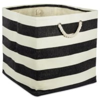 Tuck away toys, office supplies, magazines, and more in this versatile storage bin, stylish enough to sit out on shelves but small enough to place in a closet. Made from woven paper, this piece showcases a breezy cabana stripe pattern in two tones for a splash of coastal character. Two rope handles complete the look with even more nautical flair, while also making it easy to transport items stashed inside between rooms.