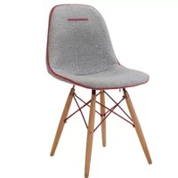 This Upholstered Side Chair transforms, and fit to any home.