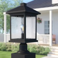 If you've ever found yourself turning to the flashlight function on your phone to light the front walkway or back deck, you might need a post lantern. Perfect for placing on a single post or a railing, this luminary is designed to live outdoors with weather-resistant materials that don't mind UV light beaming down or rainstorms rolling through. Traditional with a rustic twist, it pairs a clean-lined silhouette with a distressed finish and textured glass shade.