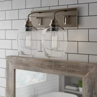 This product offers a unique vintage style design. Handblown clear seeded glass shades and braided cords are suitable for many traditional styles from historic to a vintage farmhouse. This product adds character to any space. Install in a bathroom, over a vanity or in a dining room.
