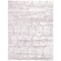 Soft to the touch, this modern viscose area rug blends neutral taupe and gray hues for a versatile addition to bedrooms. An abstract pattern lends an artistic aesthetic, all in a lustrously sleek sheen.