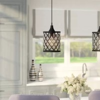 Brighten your space with a dash of bling with this pendant. Crafted of metal in a matte black finish, this fixture has a drum-shaped shade featuring trellis sides lined with transparent acrylic crystal beads. Inside, a 60 W incandescent A19 medium base bulb (not included) disperses ambient light throughout your space for a glimmering glow. The length of wire suspends the unit from a matching canopy above to round out the design.