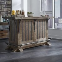 Packed with all the features you'll need to serve up the perfect libations, this Keyon Wooden Bar with Wine Storage is the life of the party. A stunning design incorporates a live, natural edge along the front of the bar top, accentuated with stylized curved top supports and dark vertical striping below. A rail-style footrest wraps around the outside of the bar, giving your visitors a comfortable place to socialize and enjoy their favorite drink.
