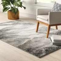 A staple for any interior design, area rugs define space in open floor plans and warm up hardwood floors. Sporting an abstract motif in neutral hues, this rug is ideal for modern homes and works just as well in transitional aesthetics. This design is crafted from machine-woven polypropylene with a flat pile that stands up to heavy foot traffic. Vacuum regularly for general upkeep. We recommend pairing this piece with a rug pad for stability.