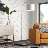 Need a light, but don't want to sacrifice a side table's real estate? That's where a floor lamp comes in handy! Perfect for lighting up the reading nook or bringing brightness to the couch, this is a multi-purpose essential in any space. Crafted from metal in a brushed nickel finish, this luminary features a slim design with an arched top that ends in a drum shade. Within, a 100 W bulb (not included) casts its glow throughout the room.