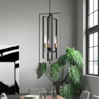 Mid-century modern design and contemporary style combine in this three-light chandelier. Crafted of steel in a matte black finish, this fixture features a geometric frame made from three concentric open rectangles. Inside, a trio of streamlined cylindrical sockets in a satin brass finish house A19 Edison-style incandescent bulbs (not included) to disperse ambient light throughout your space. Rounding out the design, an adjustable length of down rod suspends the whole unit from a canopy above.