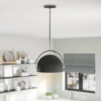 This pendant uses charcoal colored bowls to cast a great spotlight. The fixture can rotate at a wide angle to focus attention to anywhere below, making it both stylish and adaptive. This mini-pendant utilizes a two-tone rotating small bowl that can focus its light source at different angles, highlighting the objects that you want to receive the most attention.