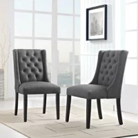 Bestow splendor with this chair. Charm and elegance adorn this luxurious button tufted dining chair complete with sleek curves and dignified form. Featuring dense foam padding, fine fabric upholstery, a solid wood frame, and non-marking foot glides, this is a stylish dining chair perfect for the modern home.