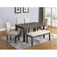 The 6 Piece Dining Set is made of solid and manufactured wood. Side chairs and bench are upholstered in a natural color. Both chairs and bench have bronze finish nail heads. The bench top is tufted.
