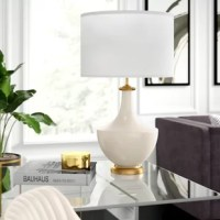 Lightweight, portable, and mindful of space, table lamps keep your home looking on the bright side with just-right task and accent lighting. Take this one for example: taking cues from both classic and contemporary design aesthetics, it showcases a curved body made from ceramic with the circular base boasts a gold coloring. Up top, its drum shade made flaunts a cream color and accommodates one 100 W lightbulb.