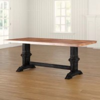 Blending traditional design with a touch of farmhouse flair, this dining table anchors your dining space in classic style. This design features a wide, 0.87