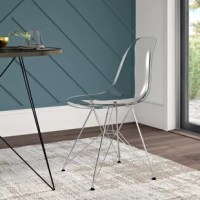 Bring an iconic mid-century modern design to your dining table with this chic side chair. Cast from polypropylene, the one-piece seat features a full back and contoured moldings for added comfort. Four chromed metal hairpin legs are capped with non-marking foot caps to save your floors from scuffs and scratches, while architectural stretchers lend added stability. Measuring 31.5