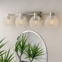 The  33.5 inch 4 Light vanity light features a transitional look with clean simple lines and clear glass. The vanity light is perfect in several aesthetic environments including transitional and traditional.