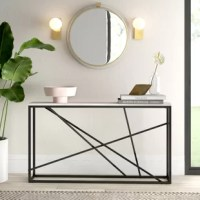 Capable of acting as a display space under a wall-mounted TV or a space-saving catch-all in the entryway, this console table is a versatile pick. Its base is crafted from powder-coated iron, striking a geometric silhouette suited for modern spaces, while the faux marble top offers a mixed media look. Measuring 29'' H x 52'' L x 10'' D, the slim design of this piece makes it suited for narrow nooks and cramped corners.