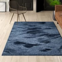 A staple for any interior design, area rugs define space in open floor plans and warm up hardwood floors. Sporting an abstract motif in cool blue hues, this rug is ideal for a modern look on your floors. This piece is crafted in Turkey from polypropylene for a colorfast touch that can stand up to regular foot traffic. A 0.79'' pile height rounds this piece out with a padded touch underfoot with digging your toes into. We recommend pairing this piece with a rug pad for stability.