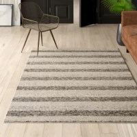 Looks aside, area rugs help absorb and decrease noise as they soften the step of hardwood and tile flooring. Made in India, this one is constructed from wool, a natural fiber with the added benefit of extra grip that promotes proper posture, better balance, and accident prevention. It features a 0.75