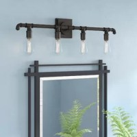 The Rayshawn 4-Light Vanity Light is perfect for modern vintage or industrial decor. With creating bold contrast and the use of vintage bulbs make this vanity light the perfect addition to your bath area.