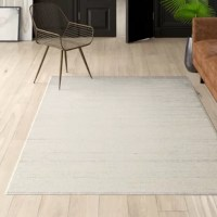 Taking cues from modern and minimalist designs, this understated area rug showcases a subtle striated pattern in neutral ivory and gray hues that blend easily with a variety of color palettes.