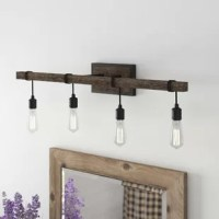 Shed some light on your master bath or powder room with this traditional 4-light vanity light. Crafted from metal, it features four bare bulbs (not included) suspended from black cords and wrapped around a bar-shaped structure, giving it a rustic look. A stainless steel backplate in a durango finish gives it a hint of accent, while its minimal design makes a big impact on your bathroom. This vanity light diffuses light from four 100W bulbs and is also compatible with a dimmable light feature.