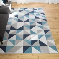 Add a pop of contemporary pattern to your floors with this area rug. In blue, gray, and teal hues, this rug has a geometric design for a timeless look. Machine-made in Belgium using a synthetic fabric, this rug features a low pile making it perfect in spaces with heavy foot traffic because it is easy to clean (just vacuum). For extra cushion and to prevent any slipping, grab a coordinating rug pad to layer underneath.