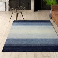 Looks aside, area rugs help absorb and decrease noise as they soften the step of hardwood and tile flooring. Made in India, this one is constructed from wool, a natural fiber with the added benefit of extra grip that promotes proper posture, better balance, and accident prevention. It features a 0.5