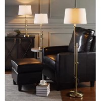This set is a cool modern approach to lighting a whole room. Featuring a set of two table lamps and a single floor lamp, this trio features a modern adjustable frame paired with hardback shades for a complete look. Use them to give a clean and uniform look to any living room, bedroom, and beyond.