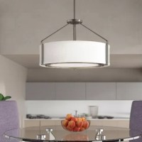 This chandelier offers a sleek metal frame that supports a low-slung shade to create a casual modern style. The frame's proportion to the white linen drum shade evokes a perfect for lighting. Includes a polished glass exterior, etched glass interior diffuser that offers an elegant appeal and is easier to clean offering both fashion and function.