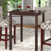 Perfect for quick morning meals and casual dinners with the whole family, this pub table will have you dining in high style. Crafted from beechwood, it features an understated, clean-lined frame measuring 38.98